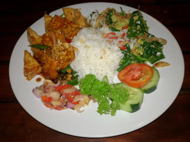 Nasi campur with fried tempeh and tofu, some sambal and small salad.