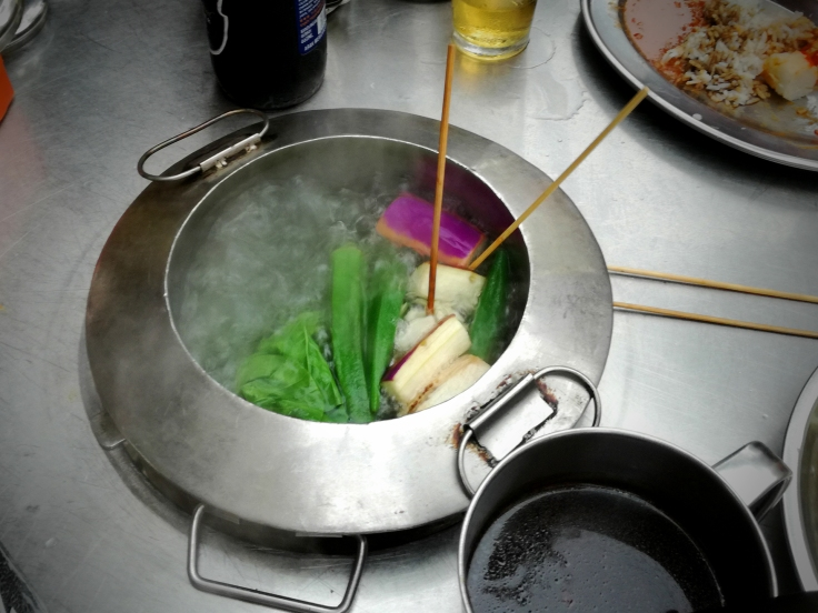 Cooking veggies in the pot inside the table :)