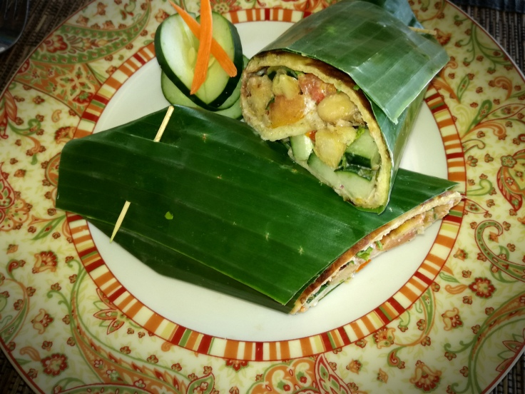 Spicy chickpeas wrap in banana leaf.