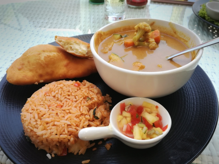 Indian Curry with Batura Bread and Tomato-Basil rice.