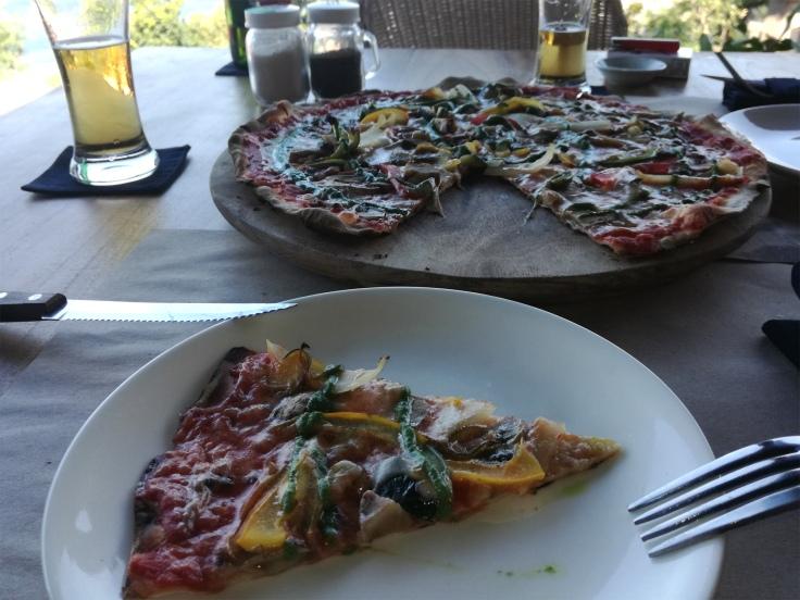 Vegetarian pizza with basil pesto.