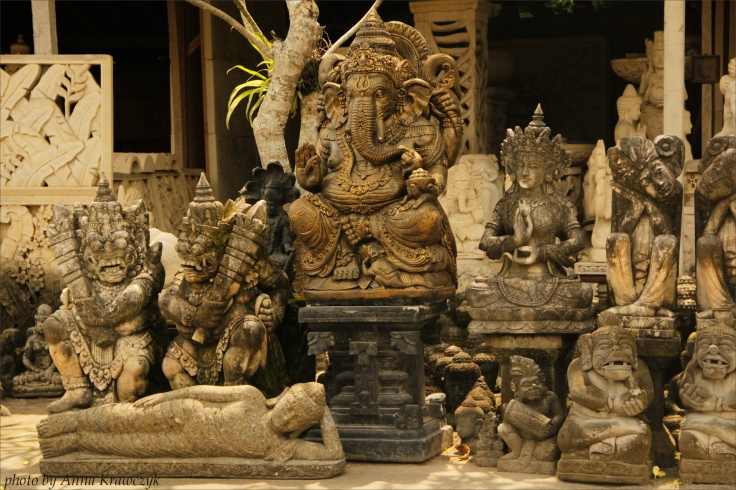 Factory and shop with statues of gods and demons.